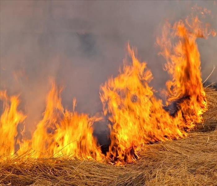large flames burning hay